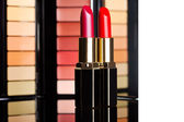 Red lipsticks with colored eyeshadows — Stock Photo