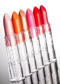 Many lipsticks on white background (shallow DOF) — Stock Photo