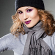 Girl in the hat and scarf — Stock Photo