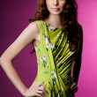 Beautiful fashionable woman in green clothes — Stock Photo