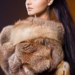 Beautiful woman in a fur coat — Stock Photo #7865052