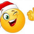 Winking emoticon with Santa hat — Vector de stock