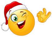 Winking emoticon with Santa hat — Stock Vector