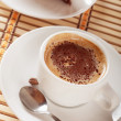 Close-up of white cup of coffee and chocolate cake — Foto de Stock