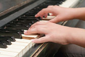 Hands playing music on the piano — Stock Photo