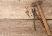 Tool against wooden wall — Stock Photo