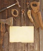 Tools against wooden wall — Stock Photo