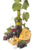 Ripe grapes, wine glass and bottle — Stock Photo