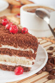 Close-up of white cup of coffee and chocolate cake — Stock Photo