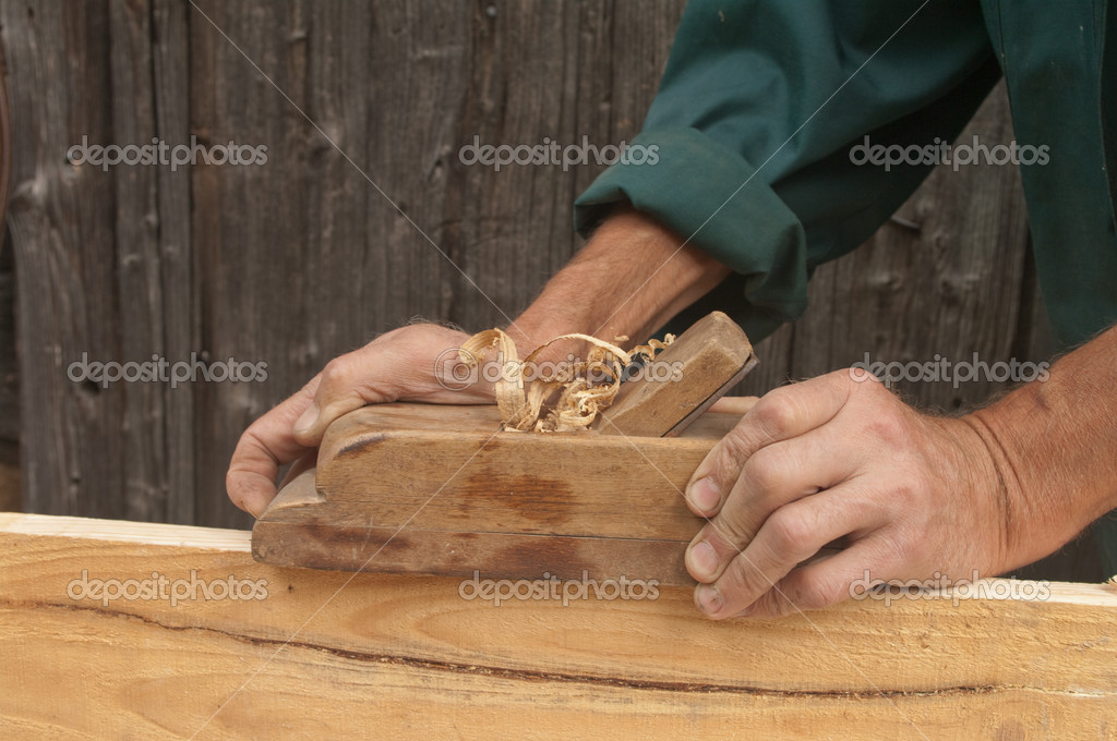 Hands of a carpenter planed wood, workplace  — Stock Photo #6983671