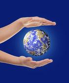 Hand holding earth — Stock Photo