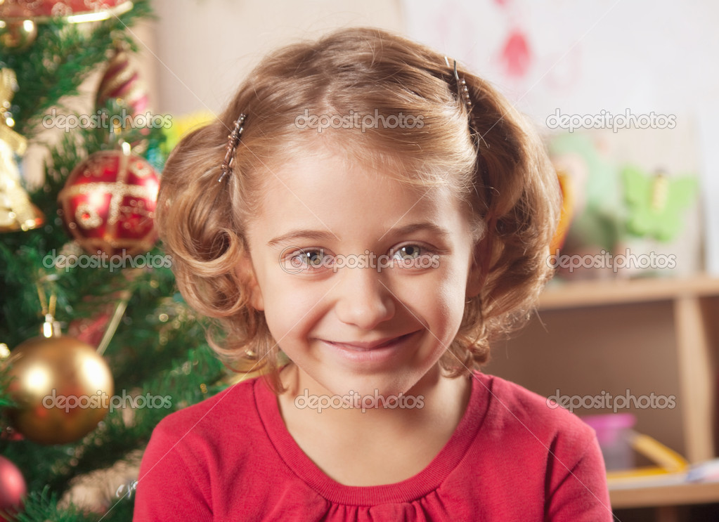 Little girl at a Christmas fir-tree.  — Stock Photo #7274151