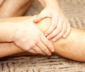 Young man having knee pain — Stock Photo