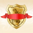 Gold shield with red ribbon — Stock Vector