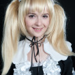 Portrait of young girl in anime lolita suit — Stock Photo