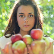 Gorgeous young girl with sappy apples — Stock Photo #6949791