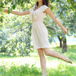 Beautiful young woman dancing in the morning bright summer orcha - Stockfoto