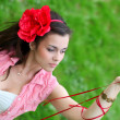 Portrait of beautiful young woman relaxing in spring park — Stock Photo