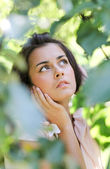 Thoughtful cute girl in nature — Stock Photo