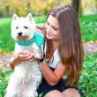 Portrait of beautiful girl with her dog — Stock Photo #6950298
