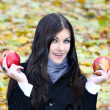 Portrait of the gorgeous woman with bright fresh red apple - Stock Photo