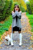 Astonishment girl with her dog — Stock Photo