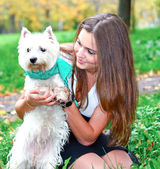 Portrait of beautiful girl with her dog — Stock Photo