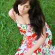 Portrait of tired young girl relaxing in spring park - Stock fotografie
