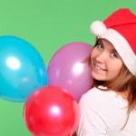 Alluring girl holding vibrant balloons — Stock Photo #6960914