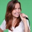 Portrait of female singer with microphone in hand — Stock Photo #6960917
