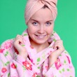 Portrait of beautiful woman in terry dressing gown - Stock Photo
