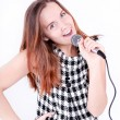 Portrait of female singer with microphone in hand — Stock Photo