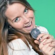 Portrait of beautiful singer girl with microphone in hand — Stock Photo #6961000