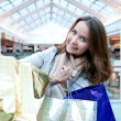 Stock Photo: shopping woman inside commercial center