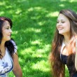 Beautiful mother and daughter enjoying in summer green park — Stock Photo