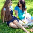 Stock Photo: Beautiful mother and daughter enjoying in summer green park