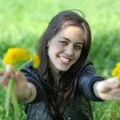 Portrait of attractive young girl with dandelion relaxing on the — Stock Photo