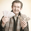 Elderly happy man with pack of money - Stock Photo