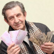 Elderly happy man with pack of money — Stock Photo
