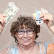 Senior happy woman with money — Stock Photo