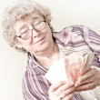 Elderly happy woman with pack of money — Stock Photo #6961804