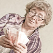Elderly happy woman with pack of money — ストック写真