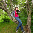Lovely girl in the deep forest sitting on branches — Stock Photo #6963103