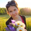 happy young girl with brigth flowers in beautiful bunch — Stock Photo
