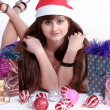 Attractive young girl with christmas vivid presents — Stock Photo #6963337