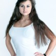 Young and seductive brunette isolated over white background — Stock Photo