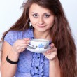 Beautiful brunette lady drinking bracing coffee — Stock Photo