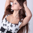 Stock Photo: Lovely brunette girl with beautiful hair