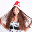 Attractive young girl with christmas hat and beautiful hair wond — Stock Photo