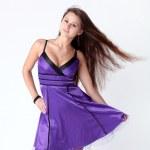 Lovely dancing girl in violet dress — Stock Photo #6963507
